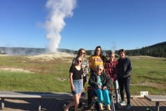Group in front of Old Faithful